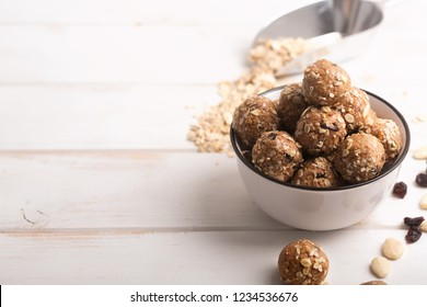 If you have a question how to make the no bake energy bites - just mix all ingredients, such as nuts, cocoa, chocolate, oats together in a large bowl until combined. Wooden background