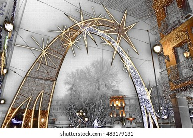 you an I, surrealistic composition of the Plaza de Zocodover of Toledo, Spain, at Christmas, illuminated with typical motives of those parties, lights, stars, comets,