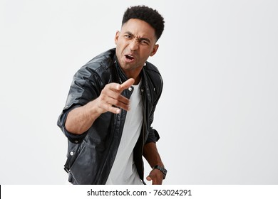 It was you. isolated portrait of mature angry black-skinned american male student with afro hairstyle in casual edgy clothes pointing at friend with mad face expression, after he betrayed him.
