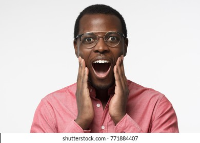 Are you kidding me? Oh my god! Wow! Really? Crazy shocked young black man, looking at camera with wide opened mouth and bugged eyes