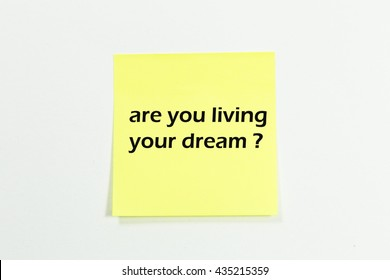 are you living your dream word written on yellow sticky notes.