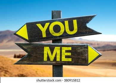 You - Me signpost in a desert background