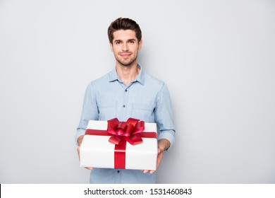 Its for you my love! Portrait of romance romantic lover guy hold gift box present for woman day give to his sweetheart wear stylish clothes isolated over grey color background