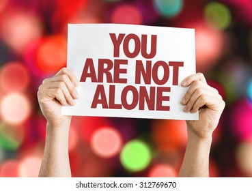 You Are Not Alone placard with bokeh background