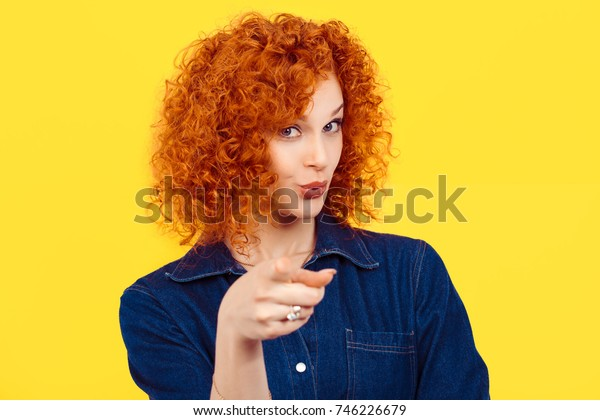 It's you! portrait of a beautiful woman redhead curly 80's retro style pointing at you camera happy isolated yellow background wall. Body language, gestures, psychology.