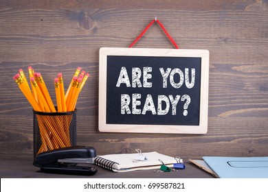 Are You Ready. Chalkboard on a wooden background
