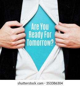 Are You Ready For Tomorrow ? Man showing a superhero suit underneath his shirt with a message text written on it