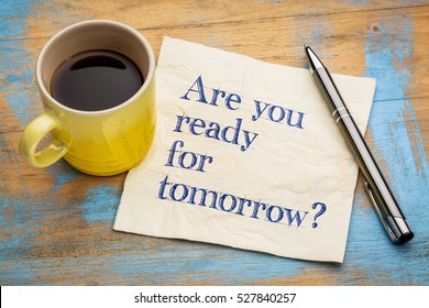 Are you ready for tomorrow question - handwriting on a napkin with a cup of espresso coffee