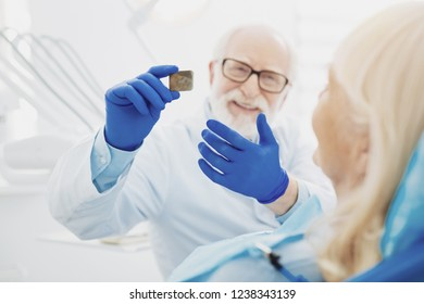 You see problem. Attractive male dentist demonstrating radiography while communicating with patient - Shutterstock ID 1238343139