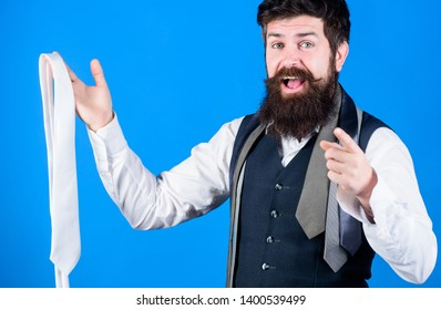 You should purchase it. Shop assistant pointing finger and offering broad assortment of neckties to purchase. Bearded man happy smiling with personal purchase. A routine purchase.