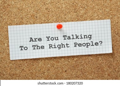 Are You Talking to The Right People typed on a piece of graph paper and pinned to a cork notice board. It is important in negotiations and planning to engage the people who can make things happen