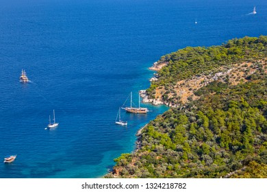 If you want to take a pleasant boat trip and enjoy the blue and turquoise waters of the Mediterranean at the same time, you can swim in Firnaz cove of Kalkan. Antalya-Turkey