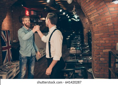 You are welcome friend! Happy satisfied client in a barber shop. Red bearded young man in a casual jeans outfit got a spectacular hairdo and his beard got cutted perfectly