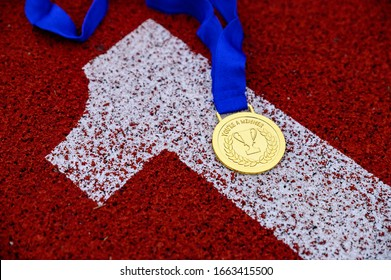 YOU ARE A WINNER, tittle at gold medal, number One at red athletics track