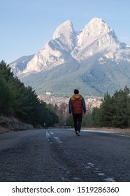 Youg man walking towards Pedraforca, a pyrenees mountain placed in Catalonia, Spain.