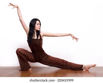 Youga or kung-fu pose.Woman posing. Isolated on white