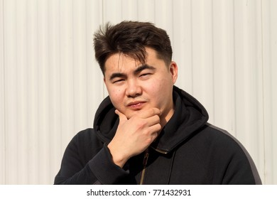 Youn Asian guy, boy is posing different face emotions on white background. Smiling, beautiful, joy, sadness, handsome, attractive, pretty, positivity, anger, actor, crazy, expressions, mad, cool.