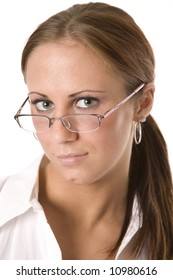yound adult woman peers out over her eyeglasses
