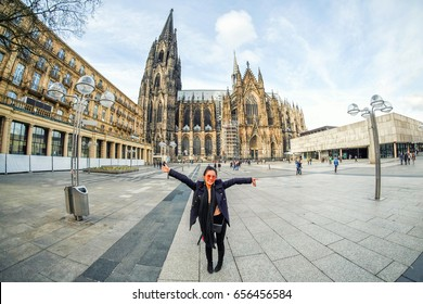 Yound beautiful woman at Cologne Cathedral in Germany