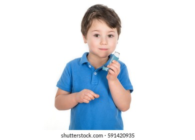 Young 5 years old boy holding a metered-dose asthma blue reliever inhaler. Copy space. White background. Isolated.