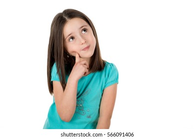Young 6 years old school girl looking up thinking looking for clues or idea. Copy space