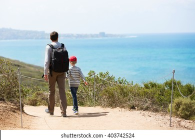 young active family of two hiking in torrey pines state natural reserve, concept of active and healthy lifestyle