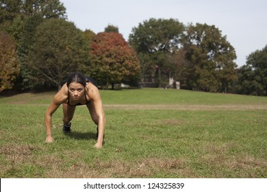 Young active female running in nature