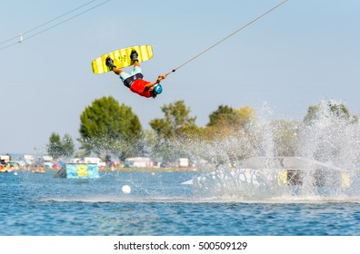 Young active man on the wakeboard in cable park (extreme water sport), Nove Mlyny, South Moravia, Czech Republic