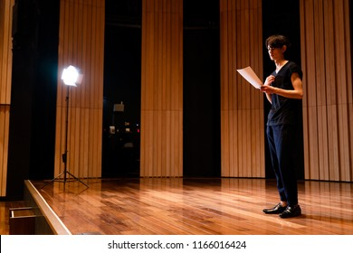Young actor on the stage.