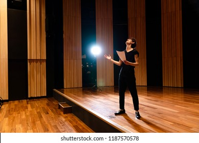 Young actor in a theater.
