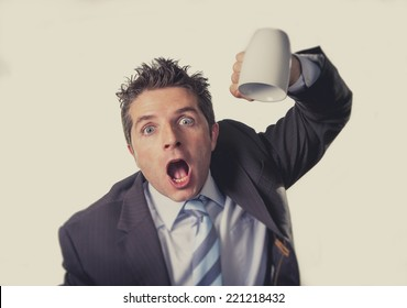 young addict business man in suit and tie holding empty cup of coffee anxious , desperate and crazy in caffeine addiction and need to keep awake isolated on clear background