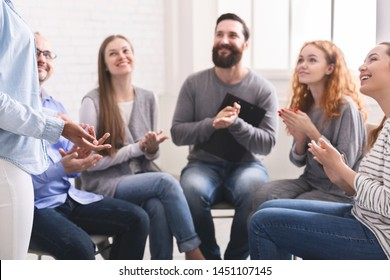 Young addicted people celebrating confession and progress, clapping hands together on special group therapy.