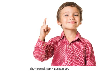 young adorable boy smiling and pointing finger upwards, isolated on white background