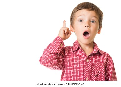 young adorable boy surprised with finger pointing upwards, isolated on white background