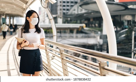 Young adult business asian working woman wear face mask for protect virus corona or covid19 and air pollution. Urban people lifestyle with public health on day concept.