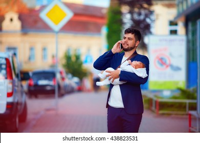 young adult businessman walking through the city with newborn baby on hands
