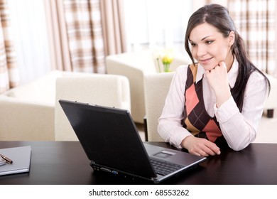 young adult businesswoman at home