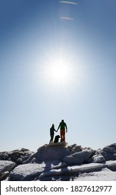 Young adult couple outdoors with dog exploring winter landscape