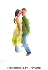 Young adult couple wearing green and having fun