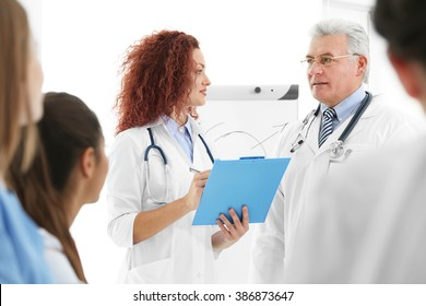 Young and adult doctors in office