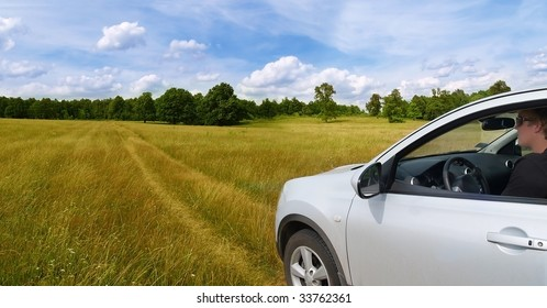 young adult driving a car in a relaxed