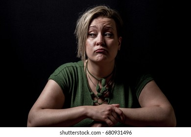 Young adult female looking on side while sad and thinking
