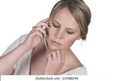 young adult female model head shot with green nail polish looking down
