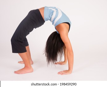 Young adult female prepares to turn herself back over after performing some stretches