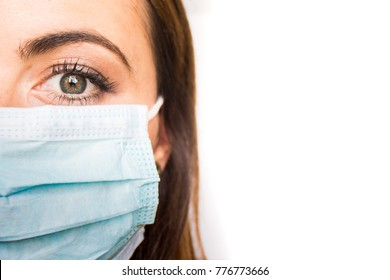 Young Adult Female Wearing Surgical Mask; Portrait Showing Left Side of Face; Copy Space (Doctor, Physician, Nurse, Tech, Caregiver)