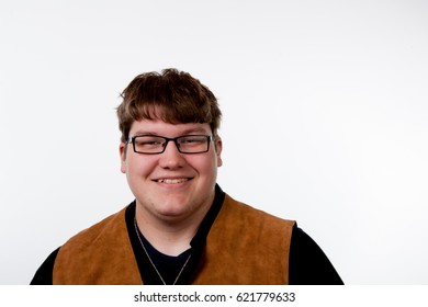 Young adult in glasses smiling