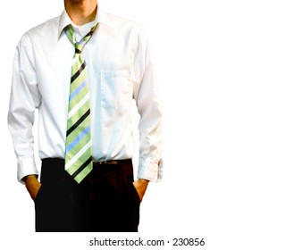 A young adult male in black pants and a white collared shirt.  The green striped tie is loosened around the neck, top button is undone.
