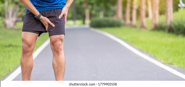 Young adult male with muscle pain during running. runner have leg ache due to Groin Pull. Sports injuries and medical concept - Shutterstock ID 1779902558