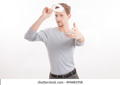 Young adult male striking a dramatic pose unmasked isolated on white background.
