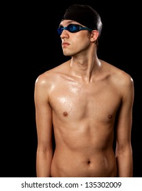 Young adult male swimmer. Studio shot over black.